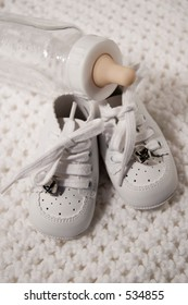 Pair of Babies first shoes and baby bottle