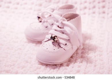 Pair of Babies first shoes with pink tint