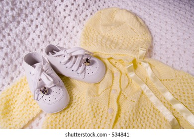 Pair of Babies first shoes and Suit