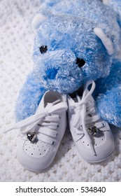 Pair of Babies shoes with Teddy Bear