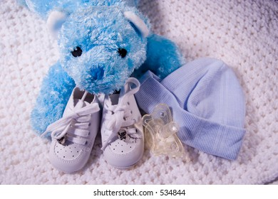 Pair of Babies shoes with Teddy Bear, cap, and Dummy