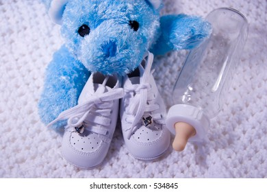 Pair of Babies shoes with Teddy Bear and Bottle