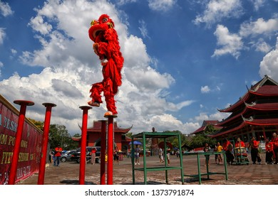 A pair of Barongsai dancers are showing their performance in Sam Poo Kong Temple, Semarang, Central Java, Indonesia, on July 26, 2017.