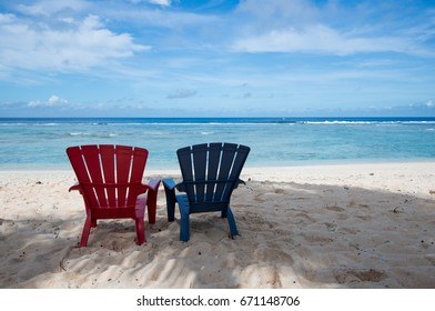 Pair of beach chairs on the Coco Palm Garden Beach in Guam, USA. The beach is one of the most famous tourist attractions in Guam.