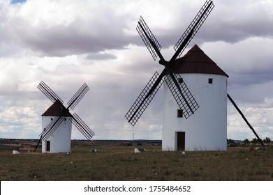 A pair of beauiful windmills. Giants of Don Quixote de la Mancha