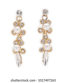 Pair of beautiful earrings with pearls on white background