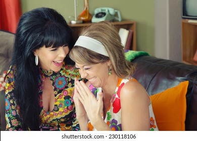 Pair of beautiful European giggling 1960s women