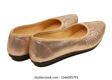 Pair of beige female shoes on white background