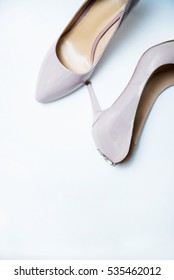 Pair of beige women's  shoes isolated on a white
