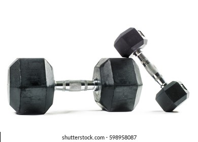 Pair of big and small dumbbell training weights isolated on white background. Weight training equipment.