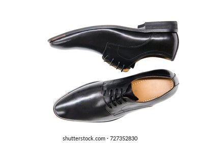 A pair of black derby shoes isolate on white background.