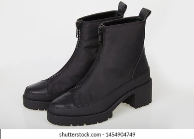 Pair of black female boots with zipper isolated on white. Ankle boots in black. Female black boots on white background