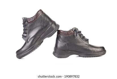 Pair of black leather boots. Isolated on a white background.