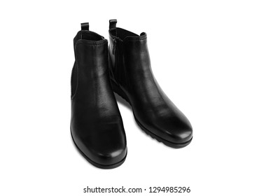 Pair of black women's leather boots isolated on white background. Short demi-season shoes, fashion and shopping concept
