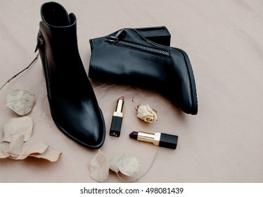 A pair of black women's shoes autumn fashion on beige background.