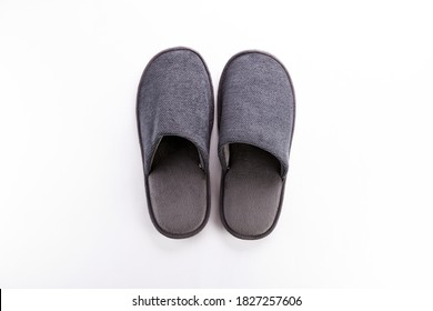 Pair of blank soft gray home slippers, design mockup. Hotel bath slippers top view isolated on white background. Clear warm domestic sandal or sneakers. Bed shoes accessory footwear.