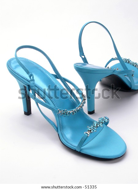 A pair of blue high heeled shoes.