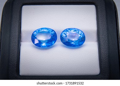 pair of blue sapphire in black and white box
