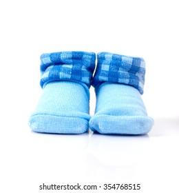 pair of blue socks for children on white background.