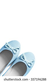 Pair of blue textile flat shoes isolated over white
