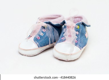 Pair of blue and white baby shoes, not isolated