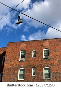 A pair of boots hangs for an electrical wire