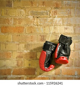 a pair of boxing gloves hanging on a wall