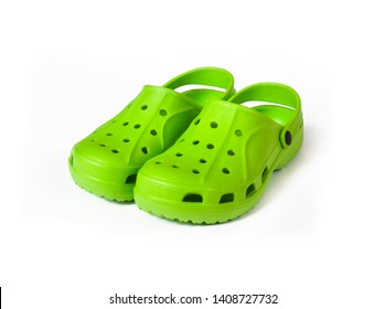 Pair of bright green clogs isolated on white background