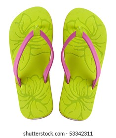 A pair of brightly colored flip flops shot on white background