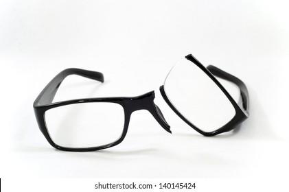 A pair of broken eyeglasses