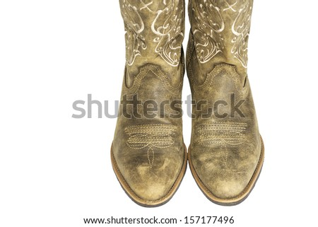 72edb769ac5 A pair of brown ladies cowboy western boots isolated on a white background.