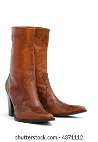a pair of brown leather cowgirl boots