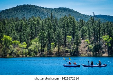 Pair of canoes on Summer afternoon at Lynx Lake in Prescott, Arizona