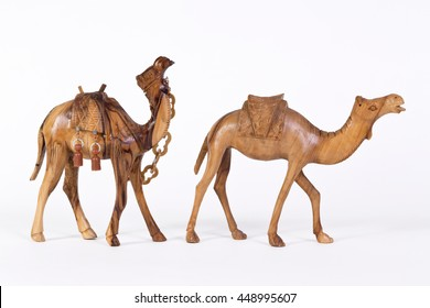 Pair of Carved Decoratd Wooden Camels over White