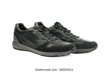 Pair of casual semi-sport black leather shoes, composition isolated over the white background
