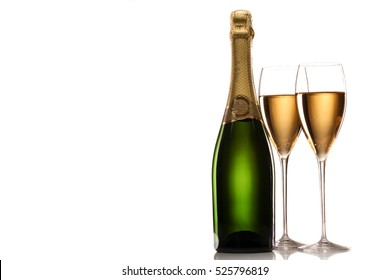 Pair of champagne flutes with bottle  isolated on white