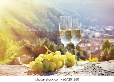Pair of champagne glasses and grapes. Bellinzona, Switzerland