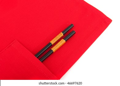 a pair of chop sticks in red place mat