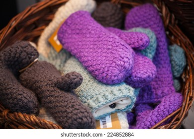 Pair of colored knitted mittens.