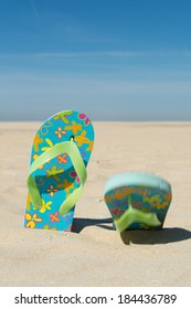 Pair colorful flip flops at the beach