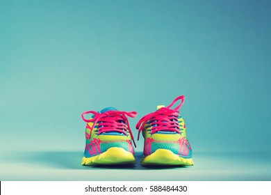 Pair of colorful running sneakers on a blue background