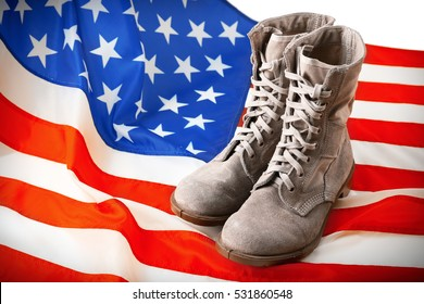 Pair of combat boots with USA flag, close up view