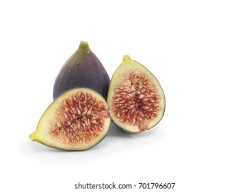 pair of  common fig from the mulberry family, whole and sliced isolated on a white background