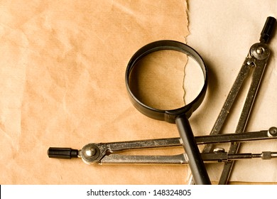 Pair of compasses and magnifying glass