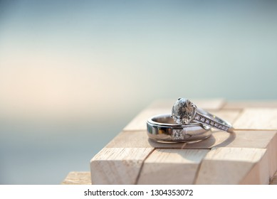 pair of couple wedding diamond  ring on wooden background
