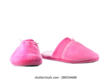 Pair of cozy and warm slippers on a white background