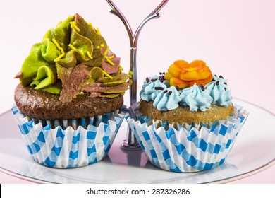 Pair of cupcakes on a serving plate