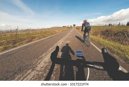 Pair of cyclists riding a road bike in winter season