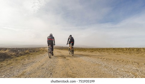 Pair of cyclists in a tuscany countryside