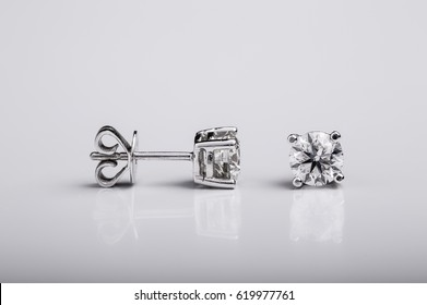 Pair of Diamond and white gold stud earrings on white background